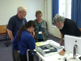 MRC Volunteers work on a sad iMac
